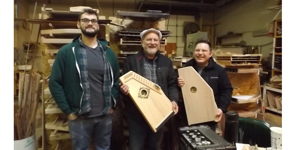 Taking a break from work in the d'Aigle Autoharps workshop to show off some of their instruments: Greg Olson, Pete Daigle and Keith Daigle