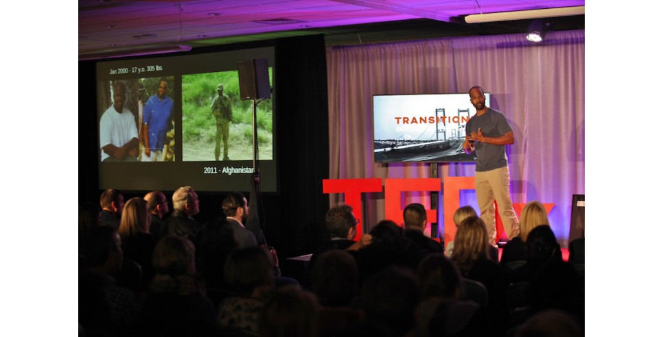 Travis Daigle speaking at a TEDx Tacoma event in 2018