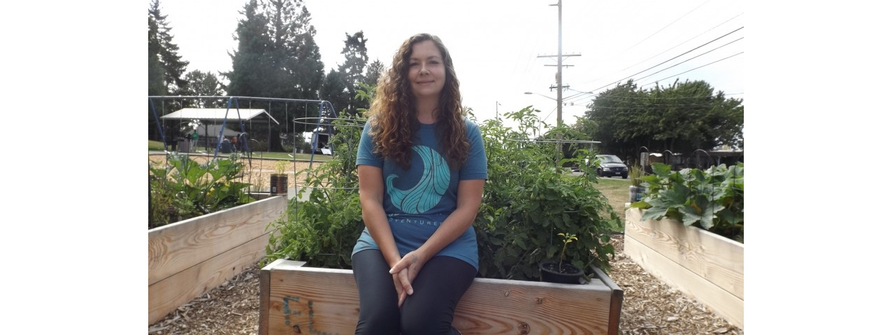 Alena Rogers in the community garden she started – photo credit Barbara Lloyd McMichael